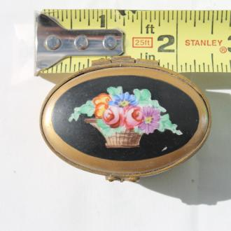 Gold plated china box with hinged black lid and basket of flowers painted on top