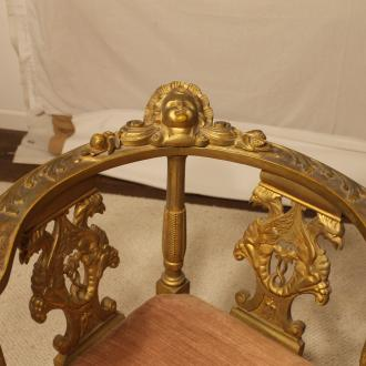 ornate scroll on the vintage pink velvet furniture