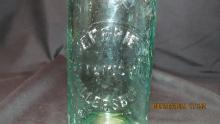 The front of the Bottle with just the name